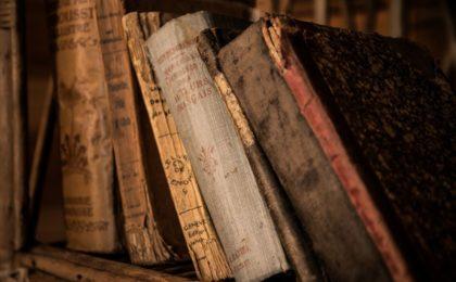 Old, vintage, weathered books on a bookshelf