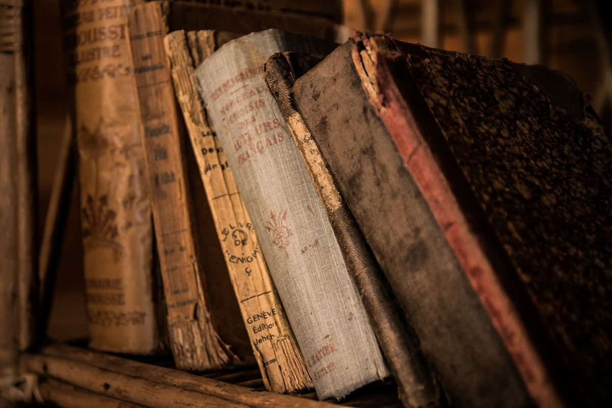 Old, vintage, weathered books on a bookshelf